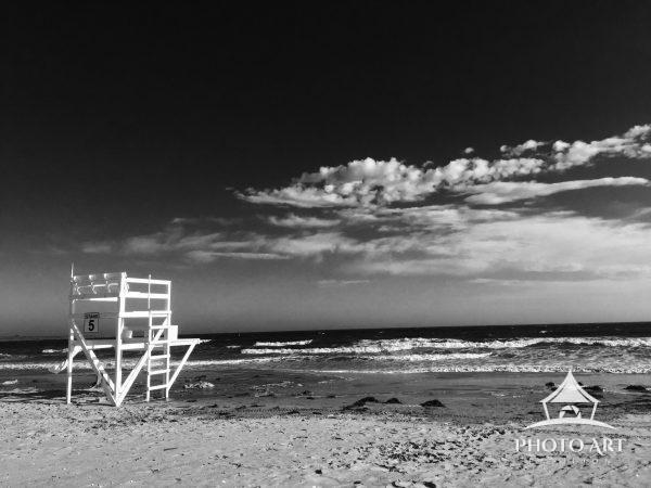 A lifeguard stand watches over an empty beach.
