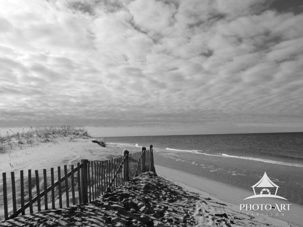 Beautiful clouds float over the beach on an early spring day.