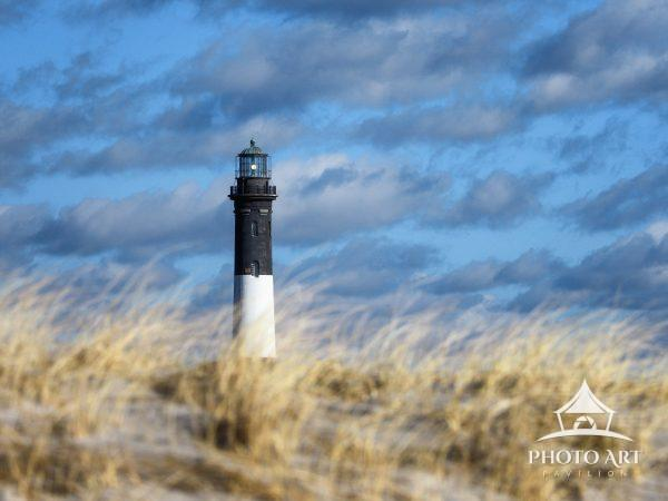 The lighthouse rises up to shine a light of hope along the windswept shores of Fire Island.