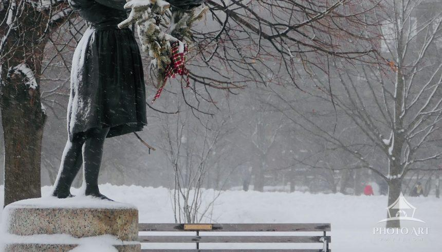 Snow falls on George Wade's Fountain Girl, a statue in Lincoln Park, Chicago, IL. She was first