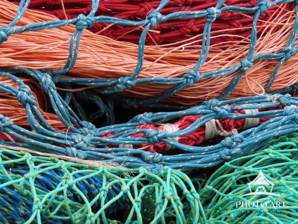 In the fishing village of Howth Ireland, fishing nets are piled on the pier awaiting their next