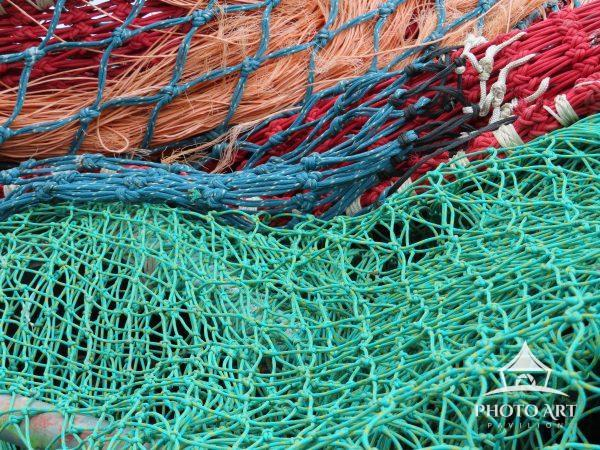 In the fishing village of Howth, Ireland, these colorful and intricately knotted fishing nets are