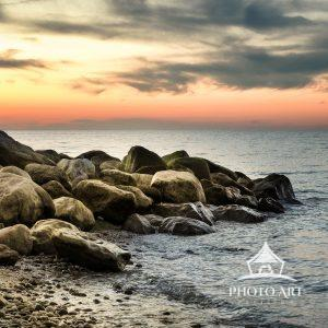 A serene moment as the sun softly sets over Long Island Sound at the end of a beautiful autumn day.