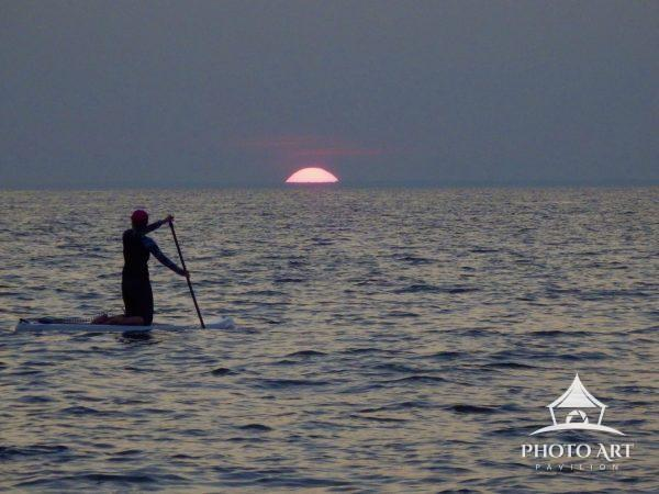 Paddle boarding at sunset in West Meadow Beach Stony Brook N Y