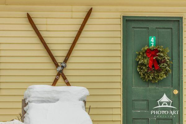 It's February! A pair of skis and a leftover Christmas wreath is the perfect combination to display