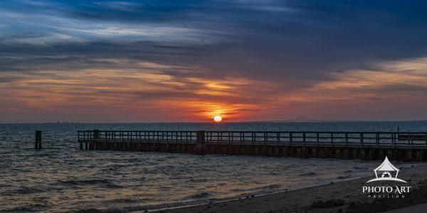 The sun sets over the Great South Bay giving up the last of it's warmth