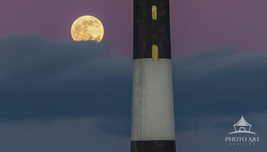 """The last Full Moon of the decade, otherwise called the """"Cold Moon"""" rises above the cloud banks to"""
