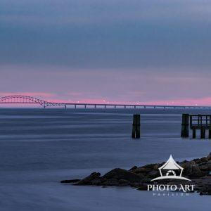 The Robert Moses (Bay) Bridge highlighted by the last glow of twilight after an otherwise overcast