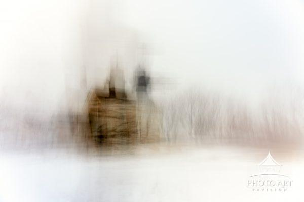 An ethereal abstract image of the Old Field Lighthouse on a snowy winter morning.