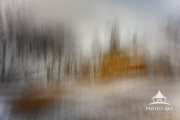 An ethereal abstract image of the Old Field Lighthouse on a snowy winter day.