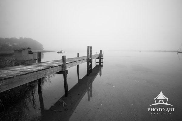 A dock in the morning fog at a mooring area on Great Peconic Bay