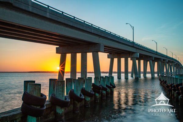 Sunset at the Ponquogue bridge in Hampton Bays