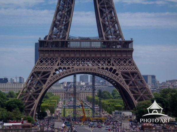 A view of the lower section of the Eiffel Tower.
