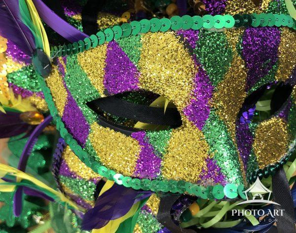 Fat Tuesday mask in bakery.