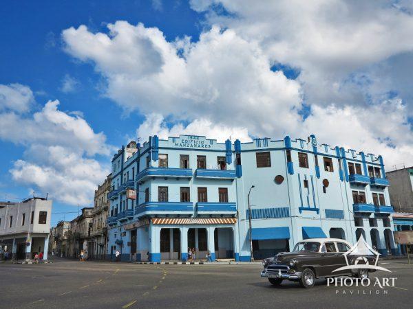 Vintage car driving around Havana