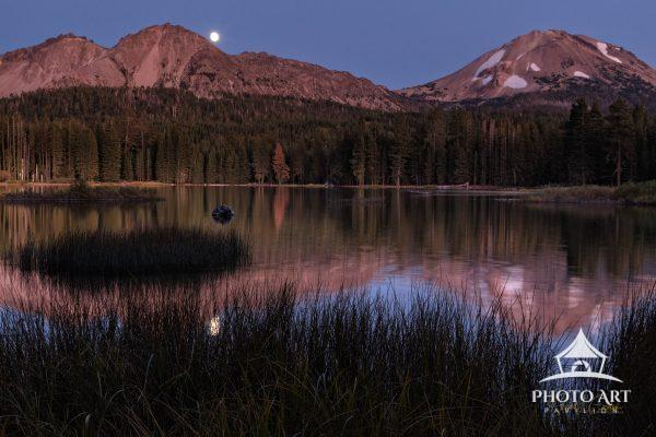 Full moon rising over Chaos Crags (left) and Mt. Lassen from the shore of Manzanita Lake.