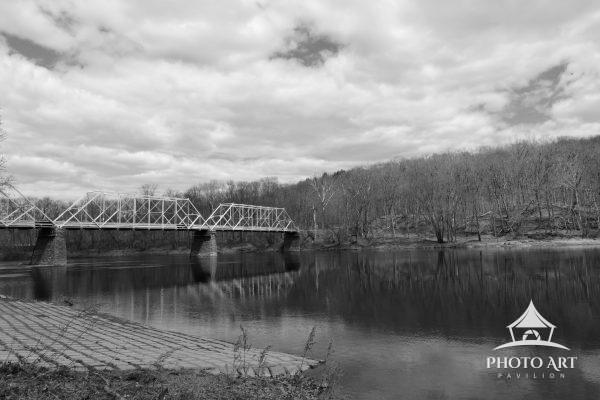 A black & white image of the Dingman's Ferry Bridge, crossing the Delaware River and connecting