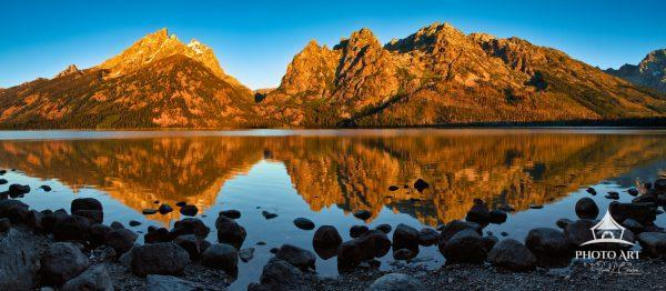 The Teton Range reflected in the surface of Jenny Lake at sunrise. Limited Edition print.