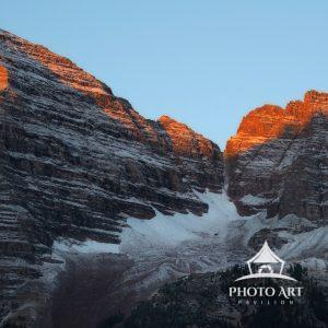 Sunrises kisses the mountain tops of Maroon Bells, Aspen Colorado