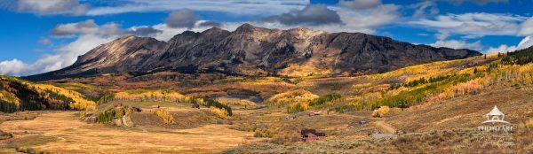Panoramic view of Colorado ranchland at the base of the West Elk mountains.