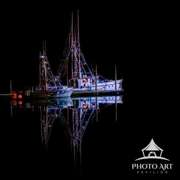A wonderfully calm night made these perfect reflections possible in Newport Harbor